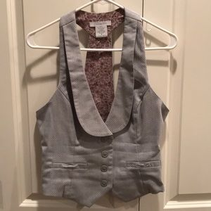 Light grey and white polka dot button vest